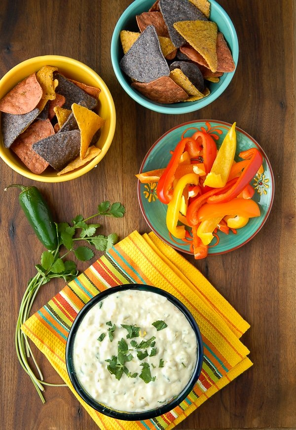 White Queso Green Chile Dip {Queso Blanco} with colorful chips and bell pepper slices for dipping