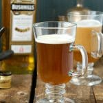 Authentic Irish Coffee recipe. Steaming hot sweetened coffee, Irish Whiskey and a cream float. Great after a big meal or to drink Irish for St. Patrick's Day without the Guinness! - BoulderLocavore.com