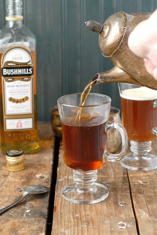 Authentic Irish Coffee recipe - pouring in the strong hot coffee