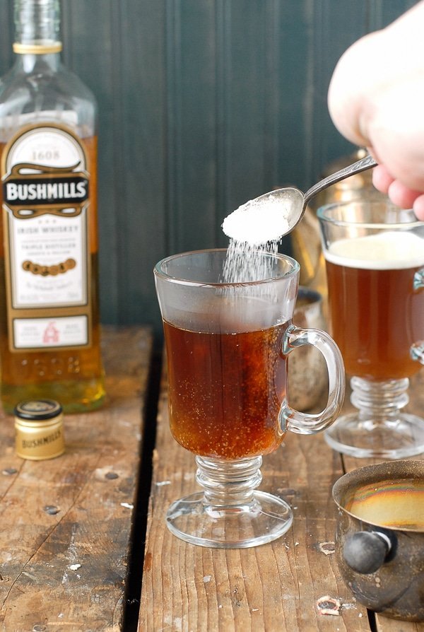 Authentic Irish Coffee recipe - pouring in the sugar - BoulderLocavore.com