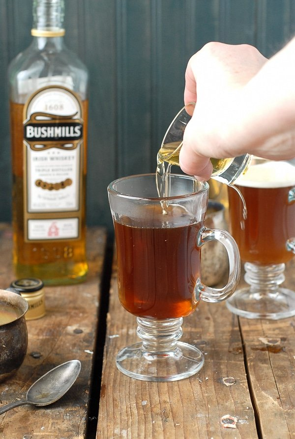 Authentic Irish Coffee recipe - pouring the Irish Whiskey - BoulderLocavore.com