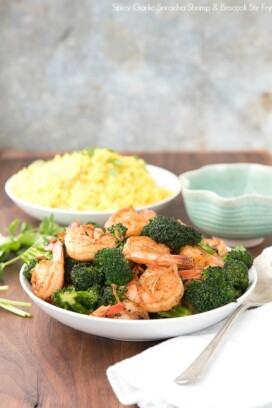 Spicy Garlic Sriracha Shrimp and Broccoli Stir Fry in a white bowl