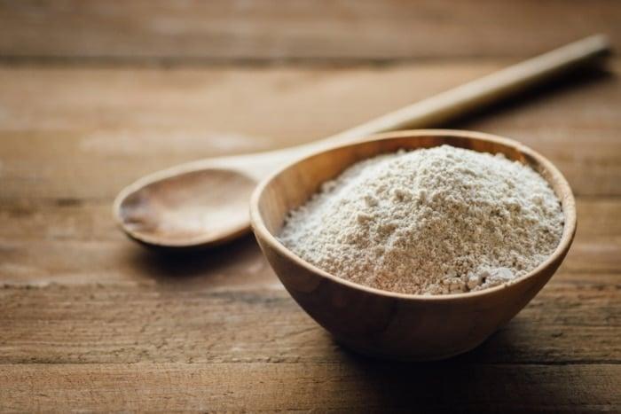 oat flour in wooden bowl