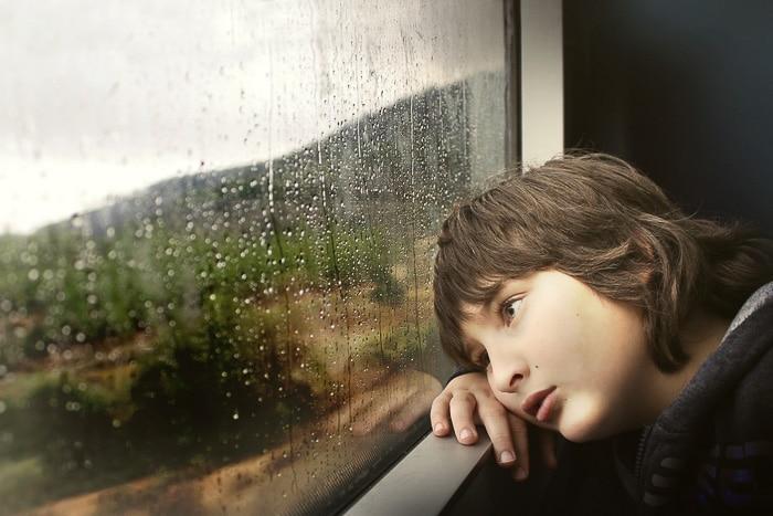 Child at a Rainy Window by Shlomit Wolf via Unsplash Stock Photography - BoulderLocavore.com