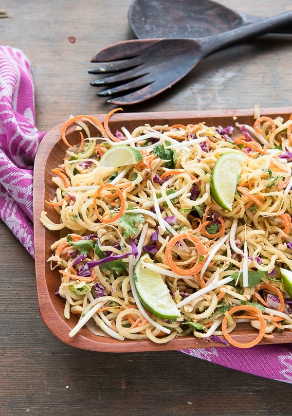 Pad Thai Salad with Spiralized Green Papaya and Spicy Peanut Dressing  in wood bowl