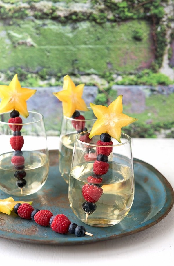 Sauvignon Blanc wine with patriotic fruit skewers {blueberries, raspberries, star fruit} - BoulderLocavore.com