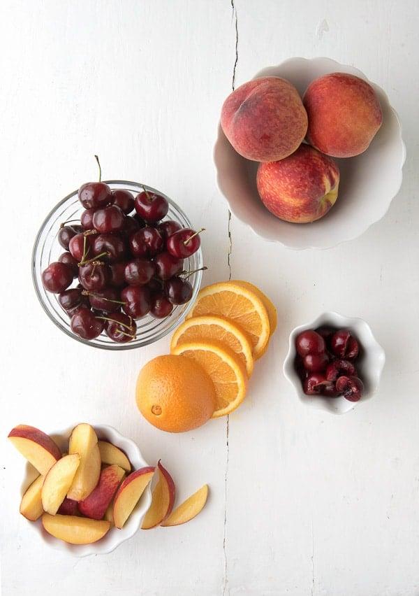 Summer Solstice wine cocktail - Cherries, Peaches and Orange Slices - BoulderLocavore.com