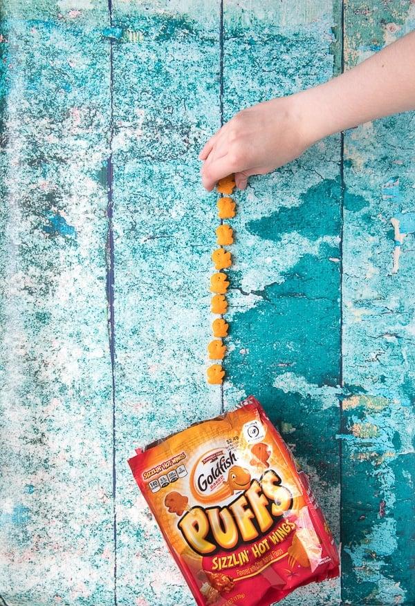 Child's Hand picking up gluten-free Goldfish Puffs 1 - BoulderLocavore.com