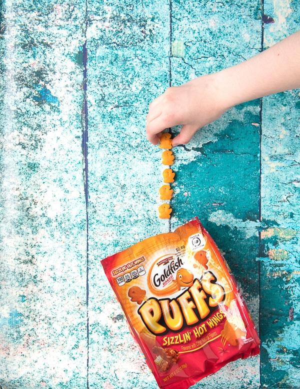Child's Hand picking up gluten-free Goldfish Puffs 2 - BoulderLocavore.com