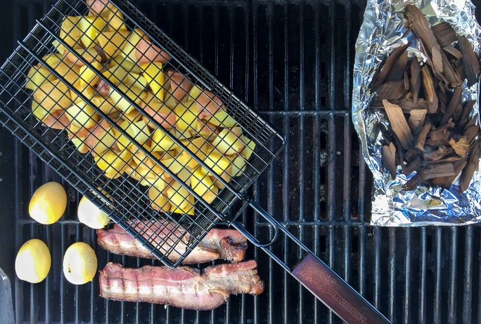Grill smoking potatoes, hardboiled eggs and bacon - BoulderLocavore