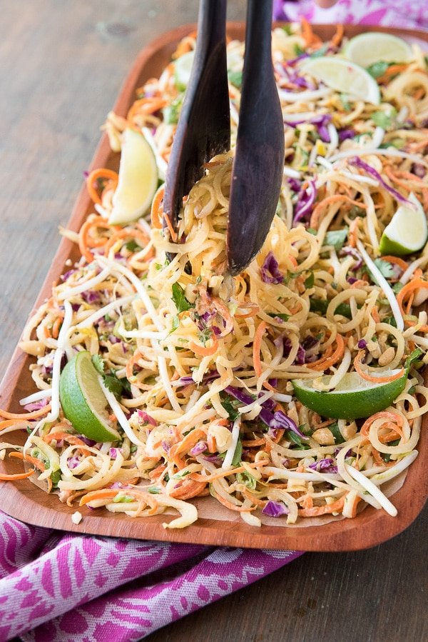 Pad Thai Salad with Spiralized Green Papaya and Spicy Peanut Dressing with tongs