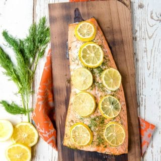 Charred Cedar Plank Salmon grilled with lemon and dill