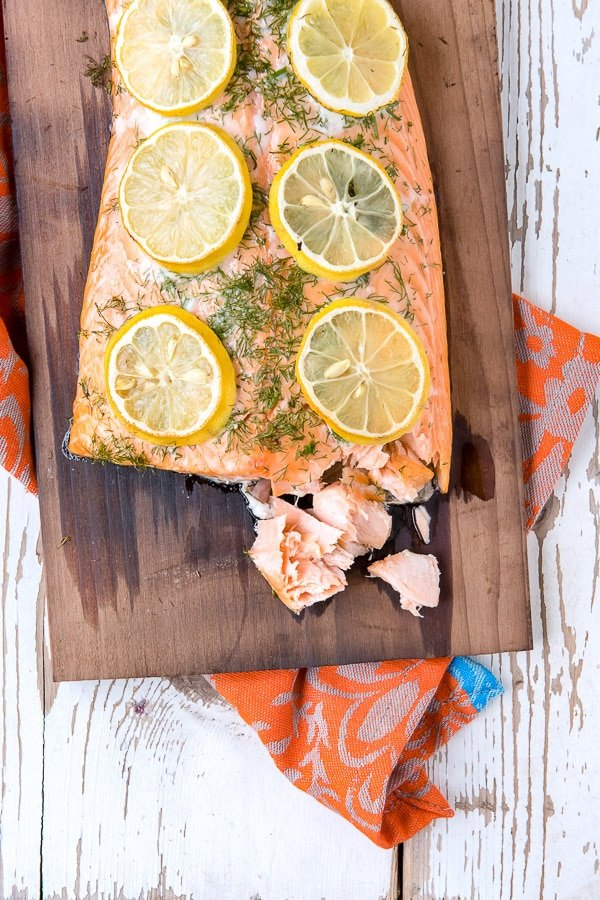 salmon cooked on cedar plank with dill and lemon