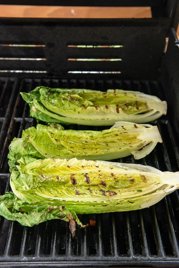Grilled romaine lettuce hearts on a grill