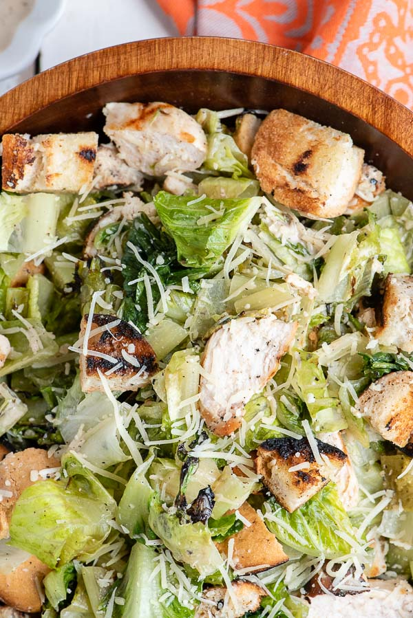 Close up of Grilled Chicken Caesar Salad with parmesan cheese