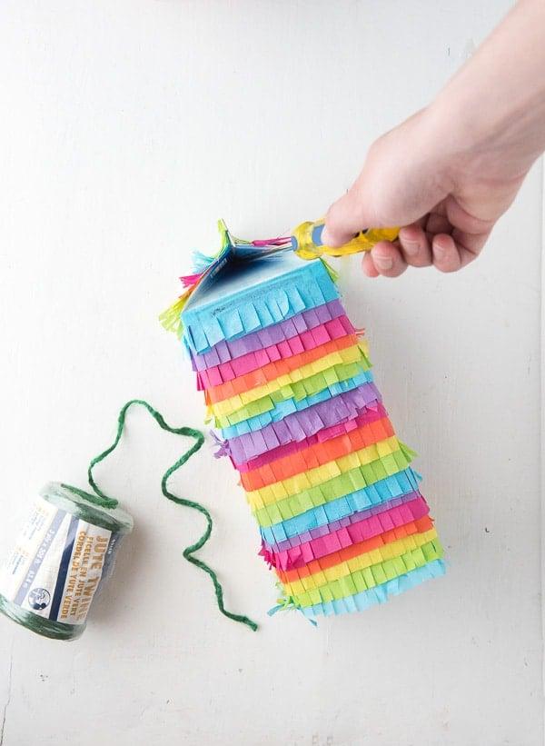 How to Make a Rainbow Milk Carton Pinata tutorial making a hole for hanging - BoulderLocavore.com
