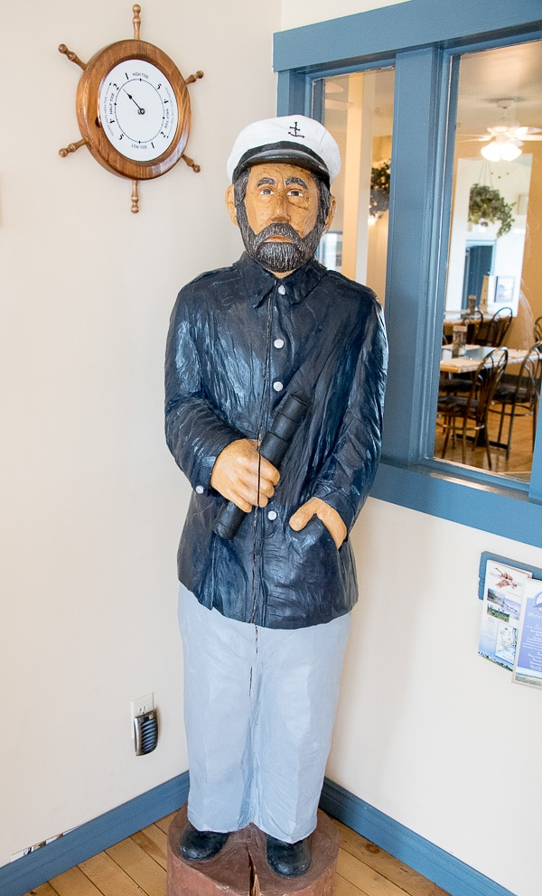 Bay of Fundy,wooden sailor statue at Tides Restaurant - BoulderLocavore.com