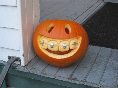 Carved Pumpkin with Braces | BoulderLocavore.com