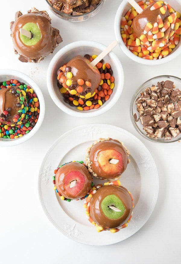 Caramel apples with bowls of candy to coat them