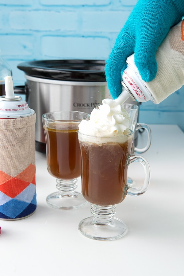 Slow Cooker Hot Buttered Rum with whipped cream - BoulderLocavore.com