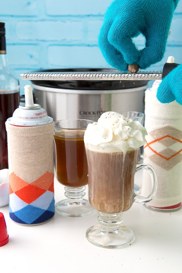 Slow Cooker Hot Buttered Rum with whipped cream and grated Nutmeg - BoulderLocavore.com