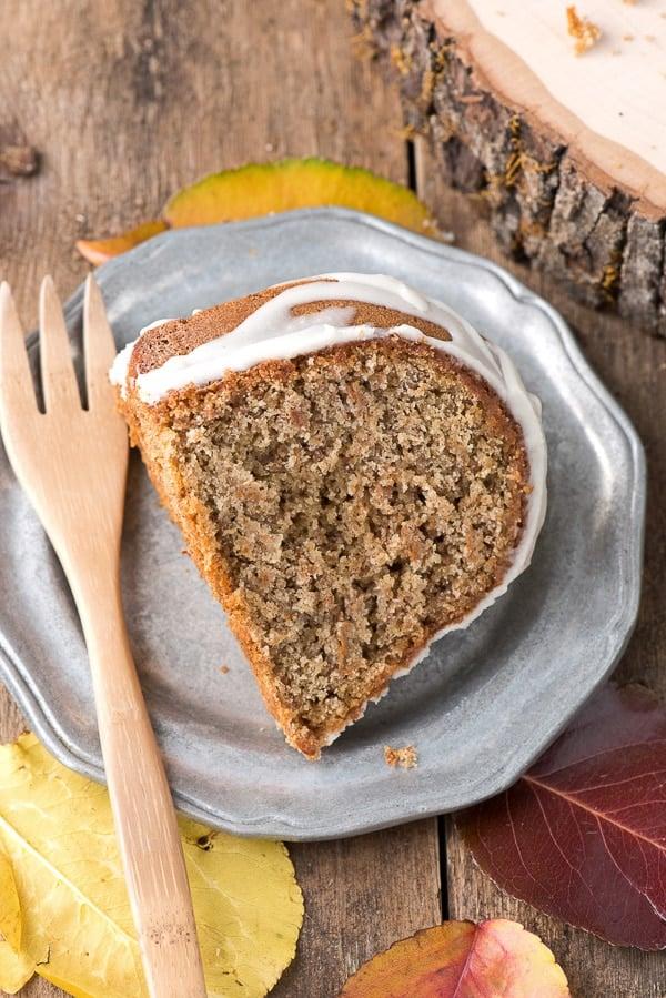 Persimmon Winter Bundt Cake with Hard Sauce Glaze slice on plate