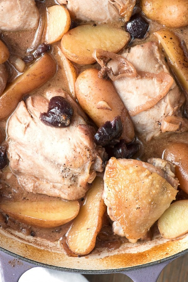 Braised Cream Sherry Chicken Thighs with Cherries and Fingerling Potatoes. This one pot recipes is sophisticated and done in an hour start to finish! - BoulderLocavore.com