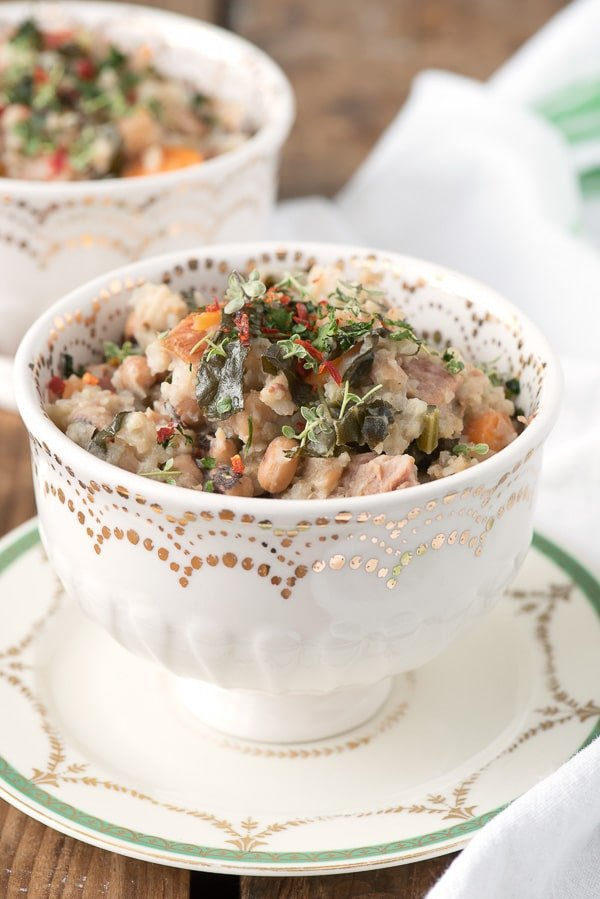 Slow Cooker Lucky Black Eyed Peas and Ham {Hoppin John}. A simple, rustic recipe of black eyed peas, ham, carrot 'coins', kale, rice and spice. Great for any day of the year, especially New Year's Day! - BoulderLocavore.com