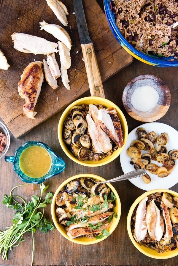 yellow bowls with ingredients needed to make Cuban Garlic Chicken Bowls