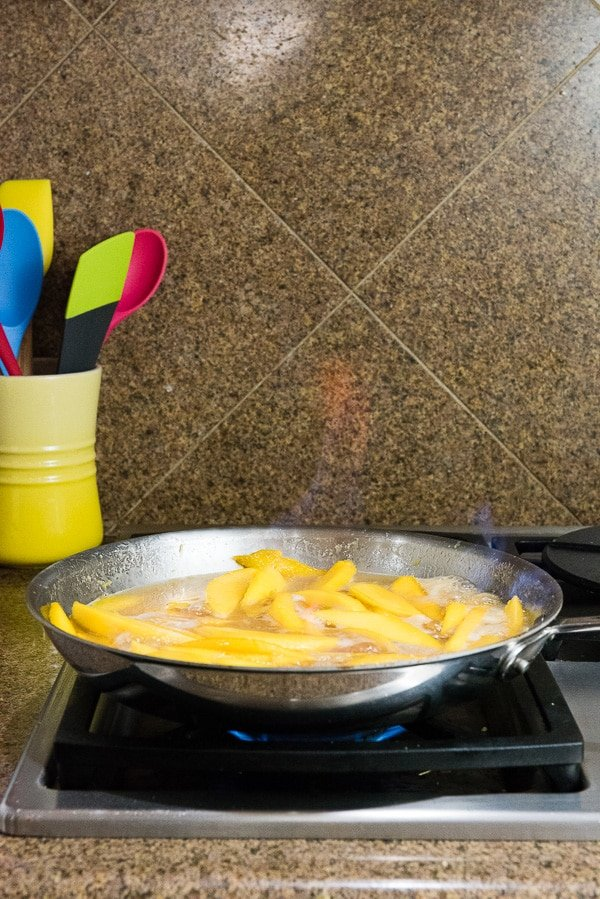 Flambeeing Mangos for Mangoes Diablo (mangos flambeed in tequila) - BoulderLocavore.com