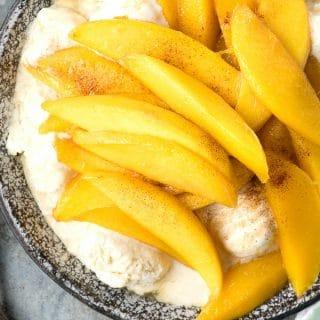 overhead photo of Mangoes Diablo (mangos flambéed in tequila) over Vanilla Ice Cream