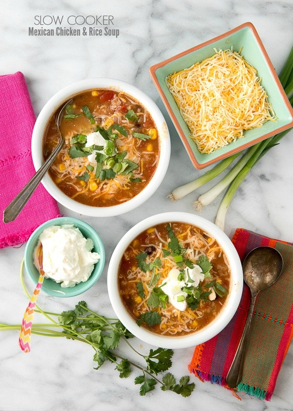 Slow Cooker Mexican Chicken and Rice Soup. This easy, hearty soup is filled with chicken, black beans, corn, tomatoes, rice and spicy broth