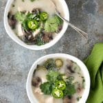 Slow Cooker Thai Chicken Mushroom Coconut Soup recipe. A light broth bursting with Thai flavors of lemongrass, ginger, garlic, lime, coconut and more!