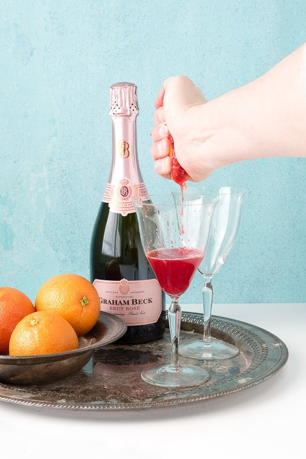 Blood Orange Mimosas (squeezing blood orange)
