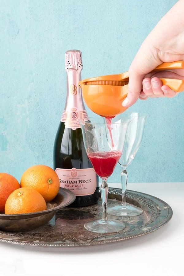 Blood Orange Mimosas with orange juicer - BoulderLocavore.com