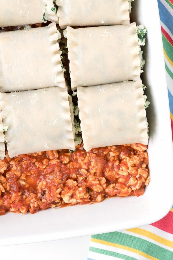 unbaked Gluten-Free Meat Lasagna Roll Ups in a white casserole dish