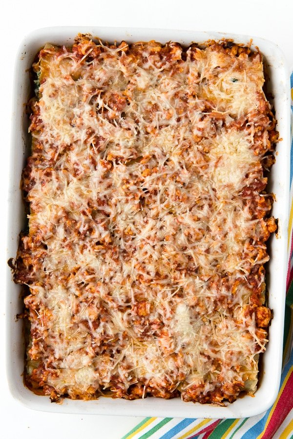 white casserole dish with Gluten-Free Meat Lasagna Roll Ups baked casserole style