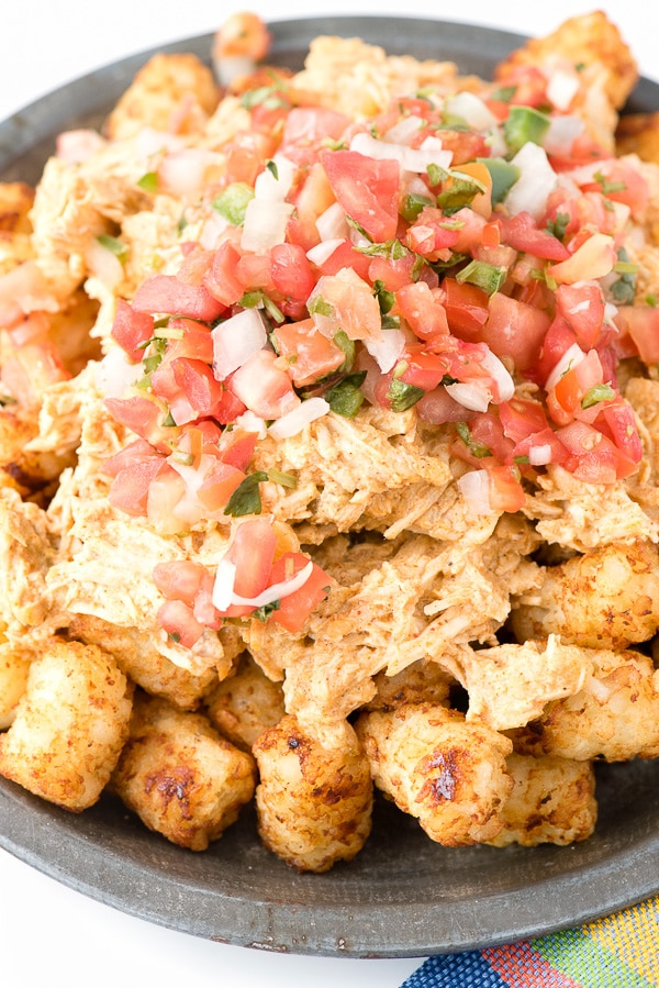 Green Chile Chicken Totchos. Tater tot style potatoes smothered in creamy Green Chile Chicken and topped with pico de gallo. Best comfort food ever! - BoulderLocavore.com