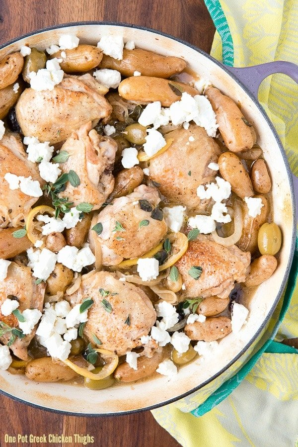 One Pot Greek Chicken Thighs shown in a Dutch oven