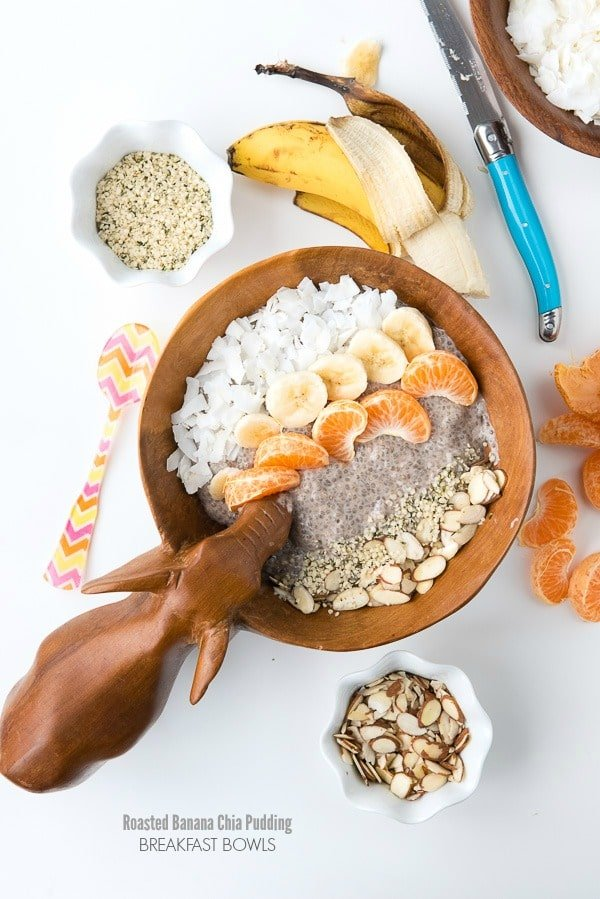 Roasted Banana Chia Pudding Breakfast Bowl surrounded by ingredients used in the recipe