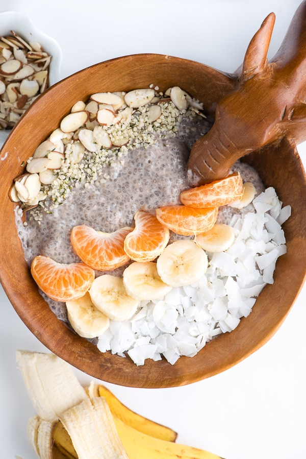 Wooden carved bowl with a Roasted Banana Chia Pudding Breakfast in it