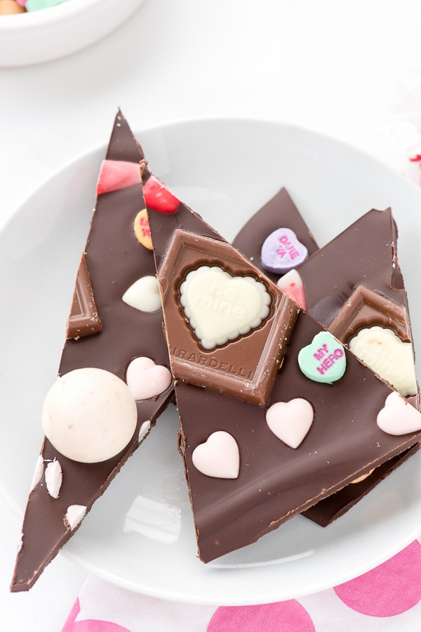 Small white plate of Valentine\'s candy chocolate bark