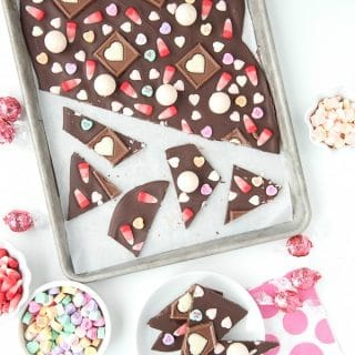 Rimmed baking sheet of Sweetheart Bark Valentine's Candy Chocolate Bark and candies