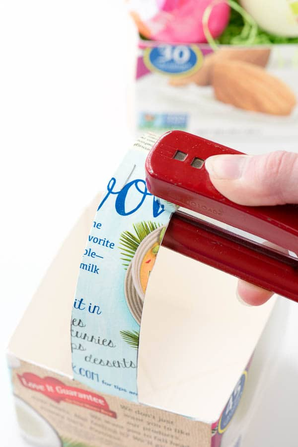 stapling a milk carton to make Milk Carton Baskets