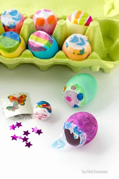 Toy-Filled Cascarones or Confetti Eggs in an egg carton with trinkets for filling eggs