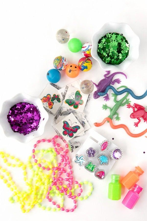 assortment of small toys, trinkets and confetti to fill Cascarones confetti eggs
