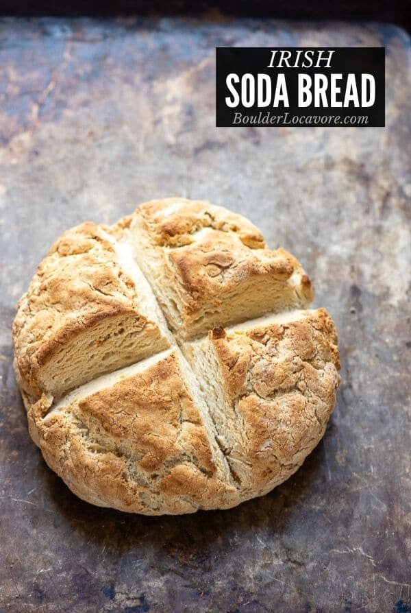 freshly baked Irish Soda Bread on a baking sheet