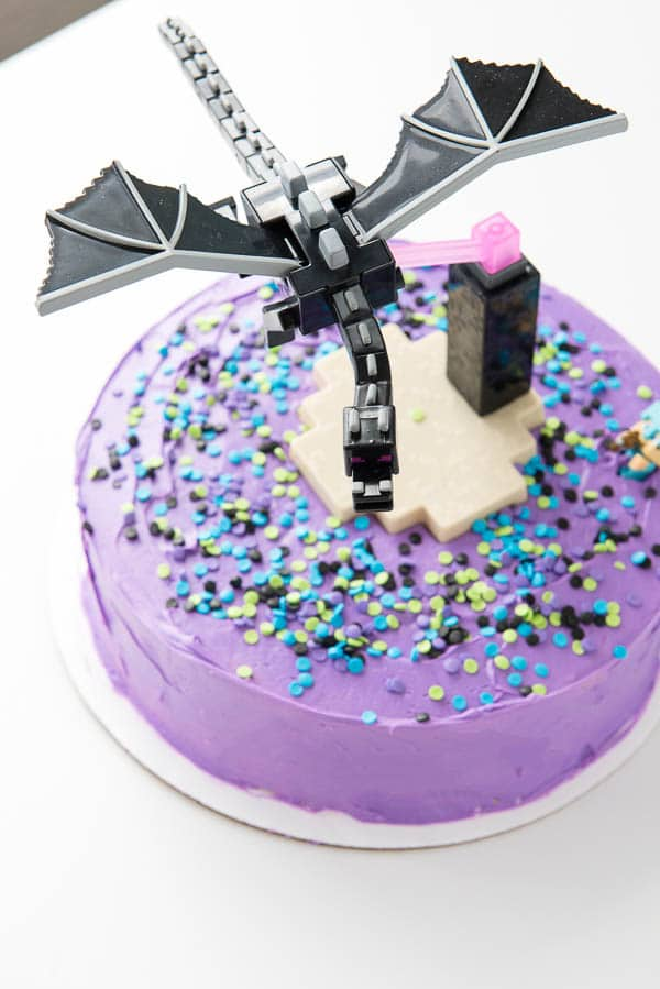 overhead image of a purple frosted Gluten-Free Funfetti Minecraft Cake