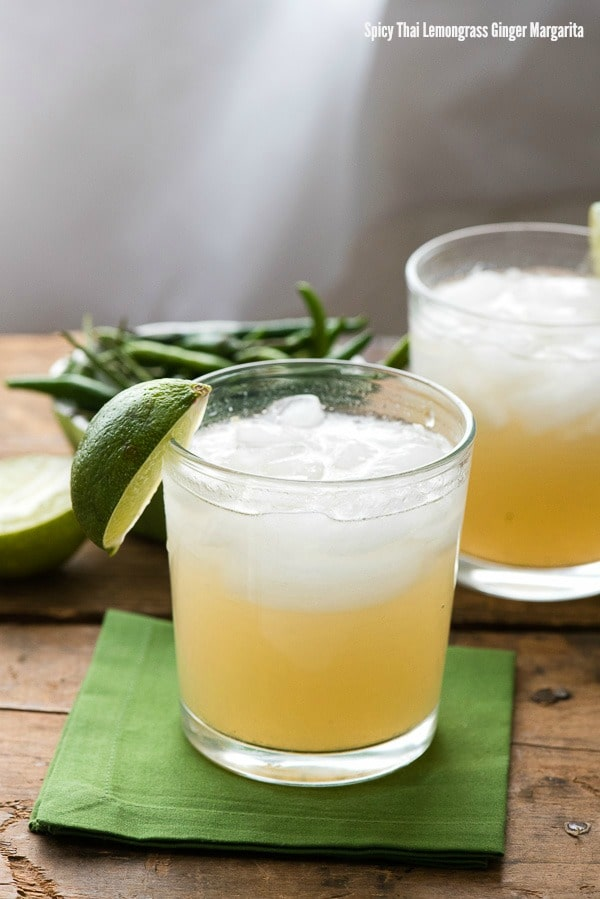 2 cocktail glasses with Spicy Thai Lemongrass Ginger Margaritas