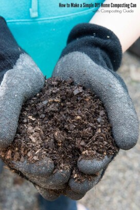 gloved hands holding compost from a home composting can